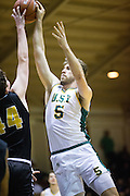 San Francisco Dons center Jimbo Lull (5) shoots a short jumper against the San Francisco State University Gators at Kezar Pavilion in San Francisco, Calif., on December 6, 2016. (Stan Olszewski/Special to S.F. Examiner)
