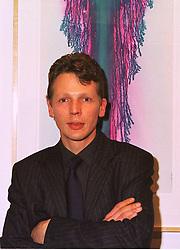 Artist the HON.RUPERT BATHURST, son of Viscount Bledisloe, at an exhibition in London on 15th December 1998.MMZ 3
