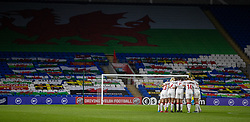 CARDIFF, WALES - Tuesday, April 13, 2021: Denmark players form a huddle before the start of the second half during a Women's International Friendly match between Wales and Denmark at the Cardiff City Stadium. (Pic by David Rawcliffe/Propaganda)