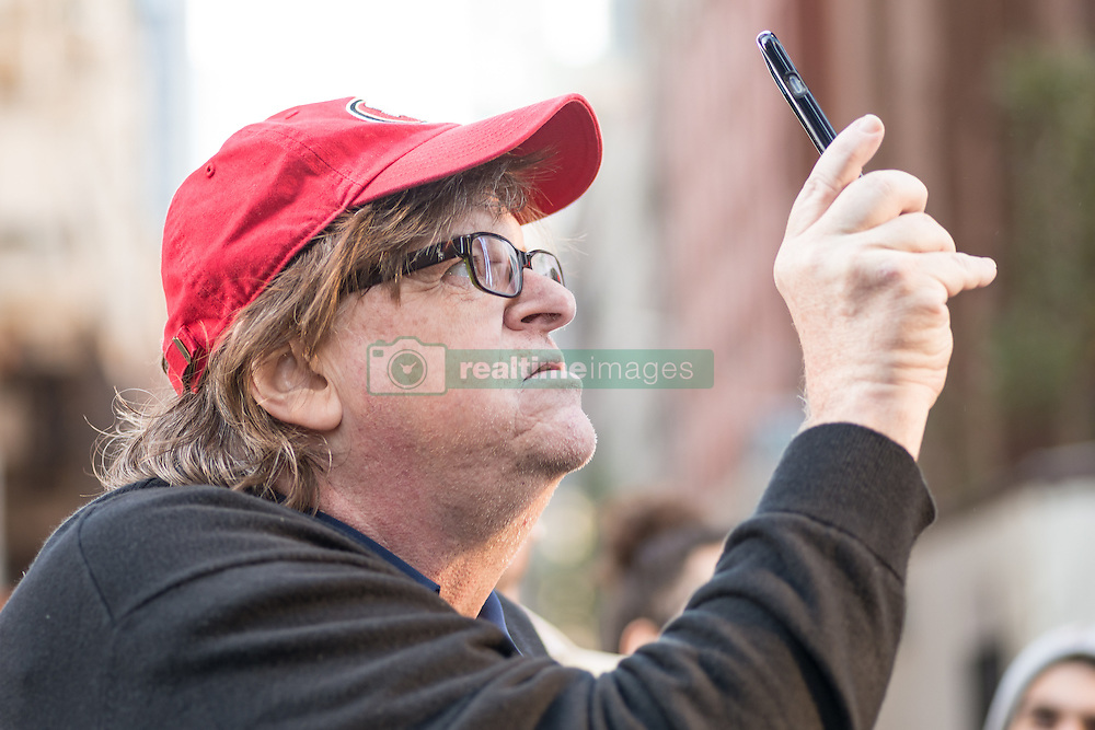 November 12, 2016 - New York, NY, United States - Filmmaker and political commentator Michael Moore is seen documenting demonstrators at their stopping point outside Trump Tower.  On the fourth day following the U.S. Presidential election, over a thousand demonstrators rallied in Manhattan's Union Square Park before marching to Trump Tower in Midtown where participants chanted and held signs expressing their objection to the political agenda of President-elect Donald J. Trump. (Credit Image: © Albin Lohr-Jones/Pacific Press via ZUMA Wire)