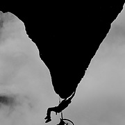 Wheelchair Rock climber Nick Morozoff hangs from a rock face in Sydney Australia. Nick was a keen rock climber before becoming a paraplegic after a car accident. After recovering from his accident Nick decided he wanted to continue his passion for rock climbing so he designed his own light weight wheelchair to accompany him.  He has since set up his own company Dynamic Living Designs manufacturing wheelchairs for the disabled.-