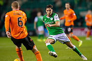 Joe Newell (#11) of Hibernian FC closes down Mark Reynolds (#6) of Dundee United FC during the William Hill Scottish Cup fourth round match between Hibernian FC and Dundee United FC at Easter Road Stadium, Edinburgh, Scotland on 28 January 2020.