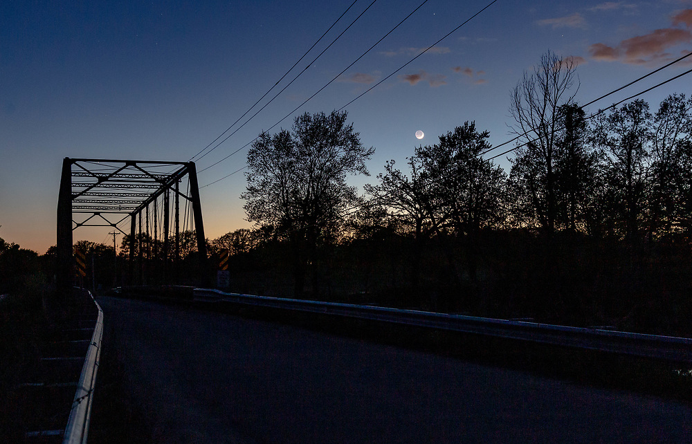 Wisconsin Rustic Road, Dane County, Dyreson Rustic Road Bridge, a truss bridge of steel built in 1897 over the Yahara River. Photo taken May 13, 2021, at twilight, eve of waxing crescent moon and Mercury conjunction.