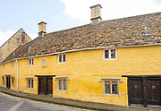 Row of historic almshouses in Kingsbury Street, Calne, Wiltshire, England, UK built 1682