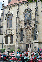 Busy street cafe  at Lambertikirche in central Munster  Germany