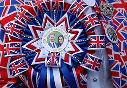 A royal fan wears a Prince Harry and Meghan Markle Union Jack rosette at Windsor Castle.