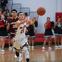 Grants Pirate Nicolas Trujillo makes a pass across the court against the Tohatchi Cougars, Tuesday Nov. 27, at Grants High School.