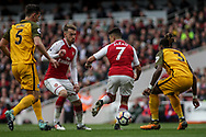 Alexis Sanchez Of Arsenal © back heels the ball as he assists Alex Iwobi of Arsenal (not pictured)  to score the 2nd goal.<br /> Premier league match, Arsenal v Brighton & Hove Albion at the Emirates Stadium in London on Sunday 1st October 2017. pic by Kieran Clarke, Andrew Orchard sports photography.