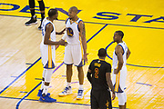 Golden State Warriors forward Kevin Durant (35) talks with Golden State Warriors forward David West (3) after being called for a foul during Game 5 of the NBA Finals against the Cleveland Cavaliers at Oracle Arena in Oakland, Calif., on June 12, 2017. (Stan Olszewski/Special to S.F. Examiner)