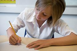 Girl writing in class,