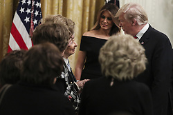 President Donald Trump and first lady Melania Trump greet holocaust survivors during a Hanukkah reception in the East Room of the White House on December 6, 2018 in Washington, DC. (Photo by Oliver Contreras/SIPA USA)