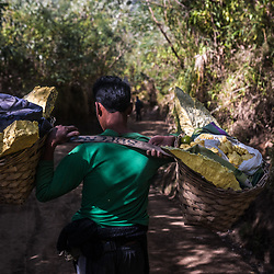 Supeno, the miner can't afford a trolley. Because the salary isn't enough to feed his family of 4 properly. He still has to carry the load of 80kg the whole way of 3km downhill. It will take him about an 2-3 hours. Trolleys cost about 2 million Rupiah (150 USD). Not all of the miners can afford one. Most of the trolleys are coming from donations. <br /> <br /> Stratovolcano Kawah Ijen (2.443 meters) on the island of Java has sulfur vents that burn with neon blue flames and the world's largest highly acidic lake. A dusty path zigzags 3 kilometers up to the crater rim. This doesn't mean anything challenging, in particular, special sights have to be deserved anyway. The irritating smell of sulfur announces the near of the crater's existence. Arriving on the crater's rim the reward for the torture becomes visible. Blue fire darts it's tongues through the fumes of sulfur dioxide.