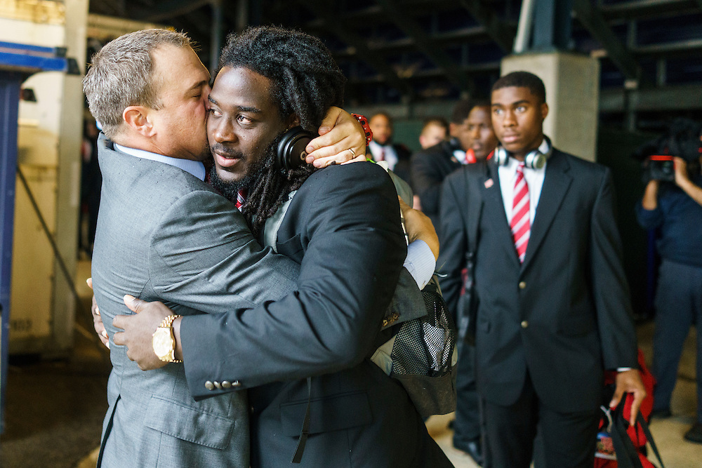 Annapolis, Maryland - October 08, 2016: Tom Herman, the University of Houston's head coach, hugs and kisses  Nomluis Fruge, a junior offensive line back before their game against Navy, in Annapolis, Md., Saturday October 8, 2016.<br /> <br /> <br /> Before every game, Tom Herman, the University of Houston's head coach, hugs and kisses each of his players during the walk from the bus to the locker room .<br /> <br /> The Cougars lost their first game of the season to the Midshipmen 40 - 46.<br /> <br /> <br /> CREDIT: Matt Roth for The New York Times<br /> Assignment ID:  30196504A