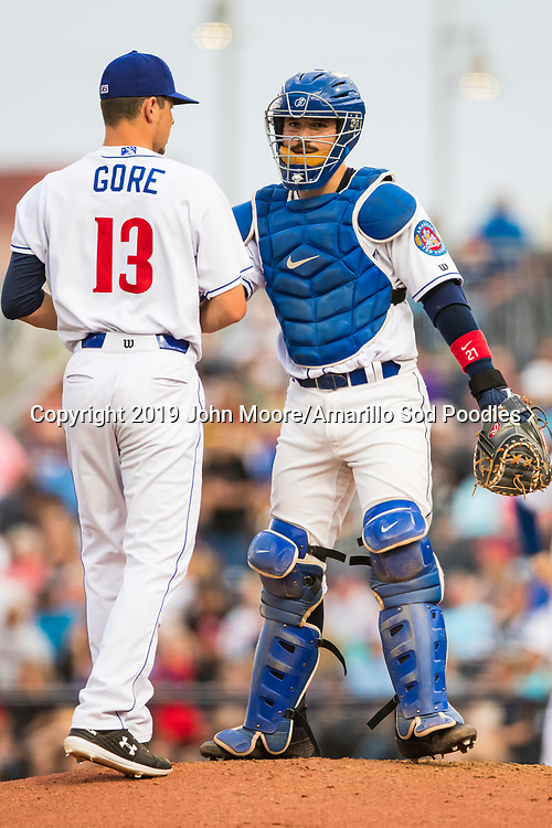 Amarillo Sod Poodles pitcher MacKenzie Gore (13) and Amarillo Sod Poodles catcher Luis Torrens (21) meet on the mound against the Frisco RoughRiders on Friday, Aug. 2, 2019, at HODGETOWN in Amarillo, Texas. [Photo by John Moore/Amarillo Sod Poodles]