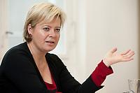04 NOV 2010, BERLIN/GERMANY:<br /> Gesine Loetzsch, Die Linke, Parteivorsitzende, waehrend einem Interview, in Ihrem Buero, Karl-Liebknecht-Haus<br /> IMAGE: 20101104-01-017<br /> KEYWORDS: Gesine Lötzsch