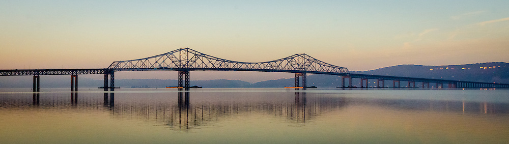 The morning sun is casting a beautiful red glow over the Tappan Zee bridge.  This created wonderful colors and reflections on the Hudson River looking south west from Tarrytown, NY