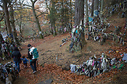 A family at a traditional Clootie Well on the 5th November 2018 in Munlochy, Scotland in the United Kingdom. Clootie wells are places of pilgrimage in Celtic areas. They are wells or springs, almost always with a tree growing beside them, where strips of cloth or rags have been left, usually tied to the branches of the tree as part of a healing ritual.