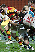 Rory Grice breaks the tackle of Tom Marshall during their Round 5 ITM cup Rugby match, Waikato v Tasman, at Waikato Stadium, Hamilton, New Zealand, Friday 29 July 2011. Photo: Dion Mellow/photosport.co.nz