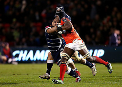 Maro Itoje of Saracens hands off Halani Aulika of Sale Sharks - Mandatory by-line: Robbie Stephenson/JMP - 18/12/2016 - RUGBY - AJ Bell Stadium - Sale, England - Sale Sharks v Saracens - European Champions Cup