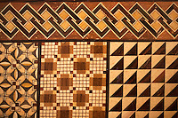Hakone parquetry began some 200 years ago and uses dozens of different types of woods to create geometric patterns and highlight the natural wood tones. In wood incrustation, the craftsman carves a board and places various kinds of wood on top to make pictures and other patterns.