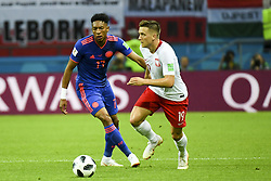 June 25, 2018 - Kazan, Russia - Johan Mojica of Colombia and Piotr Zielinski of Poland during the 2018 FIFA World Cup Group H match between Poland and Colombia at Kazan Arena in Kazan, Russia on June 24, 2018  (Credit Image: © Andrew Surma/NurPhoto via ZUMA Press)