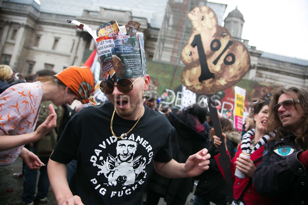Peoples Assembly March for Health, Homes, Jobs and Education. End Austerity Now! march 16th April 2016 in London, United Kingdom. Dressed up demonstrators dance at a spontaneous after party in Trafalgar Square. 50.000 thousand plus turned out to protest against the Conservative Government and their austerity policies and against tax evasions revealed in the Panama Papers.