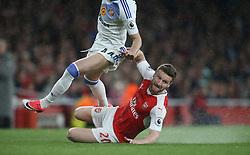 16 May 2017 London : Premier League Football : Arsenal v Sunderland :<br /> Arsenal defender Shkodran Mustafi slides along the wet turf.<br /> Photo: Mark Leech