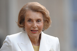 File photo - Liliane Bettencourt poses in the courtyard of the Elysee Palace in Paris, France on July 3, 2008, prior to attend a ceremony awarding designer Giorgio Armani, actress Claudia Cardinale and singer Tina Turner with France's most prestigious Legion d'Honneur medal by French President Nicolas Sarkozy. Liliane Bettencourt has died aged 94 it was announced on September 21, 2017. Bettencourt was the richest person in France and the third-richest woman in the world with a net worth of $40 billion. She was the sole heir to L'Oreal, the largest cosmetics company in the world, which was started by her father, and a large shareholder in Nestle. Nearly a decade ago a trial forced Liliane's personal business into the public light, laid bare her obsession with a flashy homosexual photographer whom she turned into a billionaire, destroyed her relationship with her daughter, turned a long time family butler against her, and, finally, turned the dowager heiress into even more of a recluse than she had been before. Photo by Orban-Taamallah/ABACAPRESS.COM