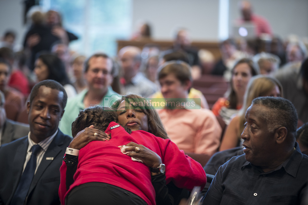 August 2, 2017 - Minneapolis, Minnesota, U.S. - School president DONNA HARRIS hugs ninth-grader ALEXIS STANLEY as she arrives at a prayer service at the Minnehaha Academy Lower School. Earlier in the morning there was an explosion that killed one, injured at least nine, and one person is still missing. ''It's such a community,'' Stanley said. ''It is a family. You just have to be there for each other.' (Credit Image: © Renee Jones Schneider/TNS via ZUMA Wire)