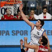 Anadolu Efes's Estaban Batista (L) during their Turkish Basketball League match Anadolu Efes between Pinar Karsiyaka at Arena in Istanbul, Turkey, Saturday, November 26, 2011. Photo by TURKPIX