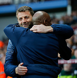 Former Tottenham Hotspur colleages Aston Villa Manager Tim Sherwood and QPR Manager Chris Ramsey hug before kick off - Photo mandatory by-line: Rogan Thomson/JMP - 07966 386802 - 07/04/2015 - SPORT - FOOTBALL - Birmingham, England - Villa Park - Aston Villa v Queens Park Rangers - Barclays Premier League.
