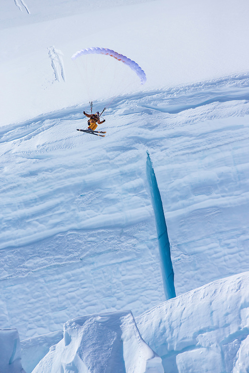 Jon Devore jumps off a large glacier while filming for the Unrideables in the Tordrillo Mountains near Anchorage, Alaska on April 29th, 2014.