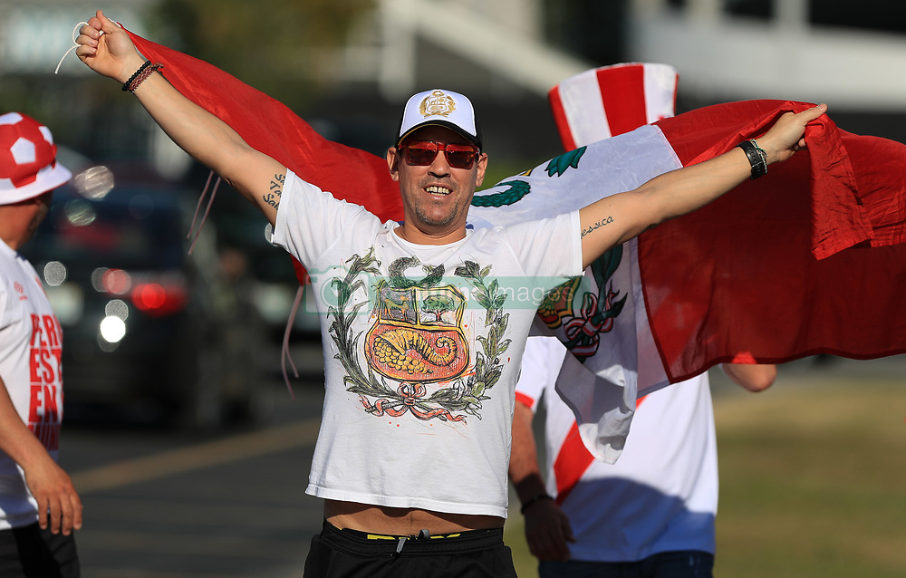 March 23, 2018 - Miami Gardens, Florida, USA - A Peruvian fan walks with the Peruvian flag outside of the stadium before the FIFA 2018 World Cup preparation match between the Peru National Soccer Team and the Croatia National Soccer Team at the Hard Rock Stadium in Miami Gardens, Florida. (Credit Image: © Mario Houben via ZUMA Wire)