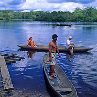 South America, Peru, Amazon River. Dug Out canoeing on the Amazon