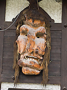 "A carved wood troll or ogre head with teeth decorates a wall in Zermatt. The famous mountaineering and ski resort of Zermatt lies at 1620 meters or 5310 feet elevation at the head of Mattertal (Matter Valley) in Valais canton, Switzerland, the Pennine Alps, Europe. Zermatt bars combustion-engine cars to help preserve small village atmosphere and prevent air pollution. The German word matten means ""alpine meadows."" Most visitors reach Zermatt by cog railway train from the nearby town of Täsch (Zermatt shuttle). Trains also depart for Zermatt from farther down the valley at Visp and Brig on the main Swiss rail network. Hike the High Route (Chamonix-Zermatt Haute Route) for exceptional mountain scenery."