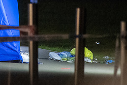© Licensed to London News Pictures. 31/05/2021. London, UK. Medical equipment  at the crime scene at Montrose Park, Edgware following the fatal stabbing of an 18-year-old male. Metropolitan Police were called at 17:54 BST on Monday 31/05/2021 following reports of a group of males fighting. The man was found suffering from a stab injury in a tennis court area. He was treated by London's Air Ambulance and London Ambulance Service at the scene but was pronounced dead at 19:19 BST. Photo credit: Peter Manning/LNP
