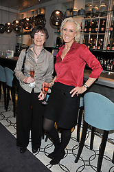 Left to right, MAIR BARNES winner of the 1989 Veuve Clicquot Business Woman Award and LAURA TENISON winner of the 2010 Veuve Clicquot Business Woman Award attending the Veuve Clicquot Business Woman Previous Winners Dinner held at Grace, 11c West Halkin Street, London on 16th April 2013.