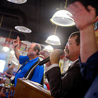 050315       Cable Hoover<br /> <br /> Auctioneer Joe Hibbard calls prices out as the audience bids during the annual Relay for Life Birdhouse Auction Sunday at Sammy C's in Gallup.