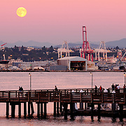 View of full moonrise in Seattle, Washington across Elliot Bay from West Seattle.