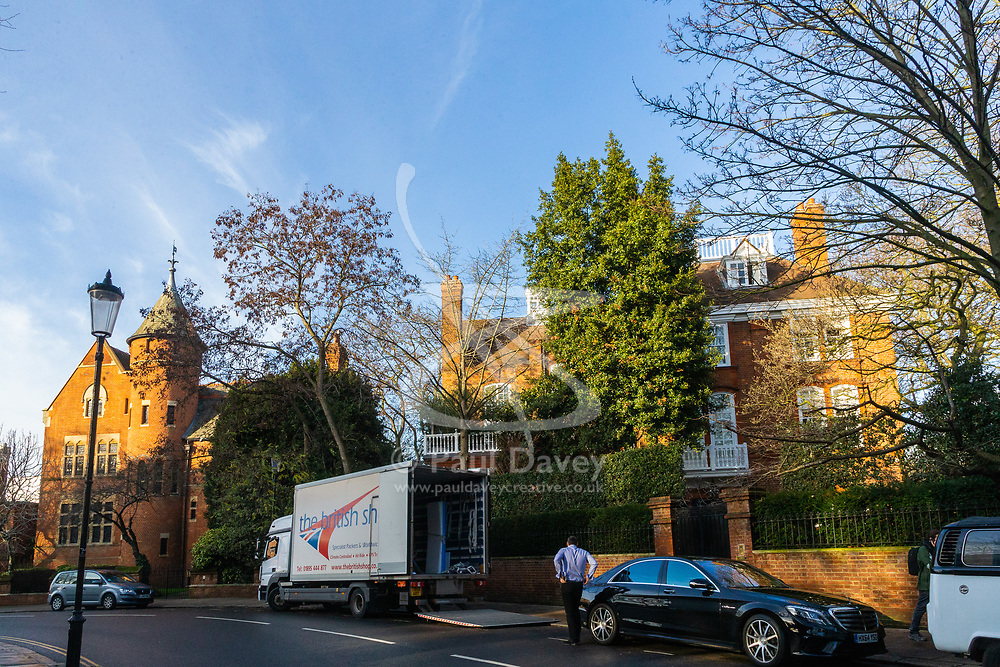 Jimmy Page's Grade I listed Tower House, left, adjacent to Robbie Williams' property, right, that he bought from the late film Director Michael Winner in Melbury Road, where Led Zeppelin guitarist Page and Solo mega-star and former Take That member Williams are locked in a bitter planning dispute over Williams' plans for an 'iceberg' basement under his home in West London's posh Holland Park. London, December 17 2018.