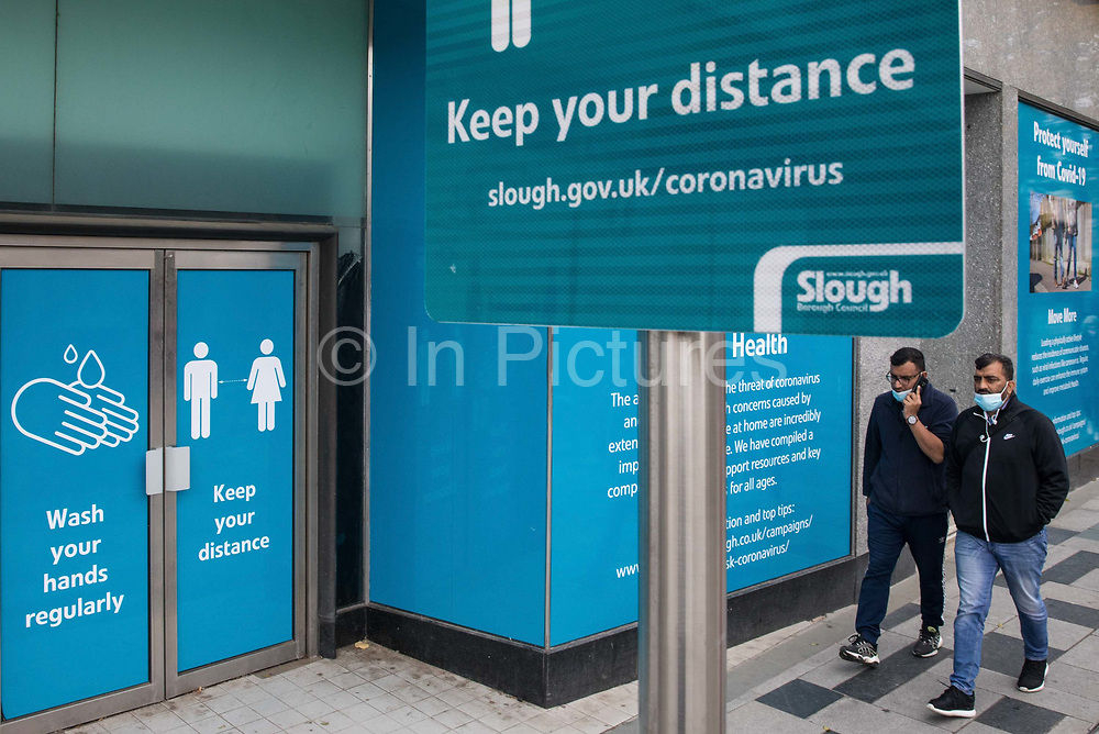 A Slough Borough Council public information display reminds local residents to wash their hands regularly and to observe social distancing to help prevent the spread of the coronavirus on 23 October 2020 in Slough, United Kingdom. The Government has announced that Slough will change its COVID Alert Level status from Tier 1 Medium Alert to Tier 2 High Alert with effect from 00:01 on Saturday 24 October following a sustained rise in COVID-19 cases resulting in an infection rate of 153 cases per 100,000.