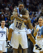 Orlando Magic center Dwight Howard, center, is congratulated by teammate Jameer Nelson after scoring a last-second dunk to beat the San Antonio Spurs as J.J. Redick, left, and Carlos Arroyo of Puerto Rico celebrate during the second half of their basketball game in Orlando, Florida.