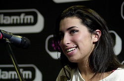 Amy Winehouse performs an Intimate set at Sheffields Hallam FM Local Radio Station<br /> 14 October 2004.<br /> Image Copyright Paul David Drabble
