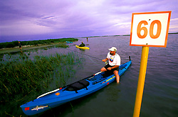 Kayak fishing at Lighthouse Lakes Texas Parks & Wildlife Coastal Paddling Trail.