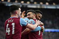 Football - 2019 / 2020 Premier League - West Ham United vs. Brighton & Hove Albion<br /> <br /> West Ham United's Robert Snodgrass celebrates scoring his side's third goal with Sebastien Haller and Declan Rice, at The London Stadium.<br /> <br /> COLORSPORT/ASHLEY WESTERN