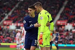 Tottenham Hotspur's Erik Lamela (left) and Stoke City goalkeeper Jack Butland confront each other