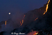 "red hot lava from Kilauea Volcano cascades down a sea cliff at dawn, creating heat waves that cause the full moon to shimmer, Hawaii Volcanoes National Park, Hawaii Island (""the Big Island""), Hawaiian Islands, U.S.A."