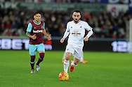 Leon Britton of Swansea city in action. Barclays Premier league match, Swansea city v West Ham Utd at the Liberty Stadium in Swansea, South Wales  on Sunday 20th December 2015.<br /> pic by  Andrew Orchard, Andrew Orchard sports photography.