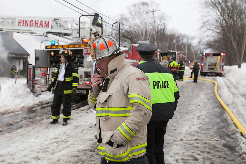 Hingham, MA 02/11/2013.Hingham Fire Chief Mark Duff gives an order at the scene of a 3 alarm house fire at 276 East St. in Hingham on Monday, February 11..Alex Jones / www.alexjonesphoto.com