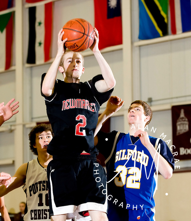 Newmarket's Joe Downing grabs a rebound in Sunday's High School Senior All-Star event at the NH Techincal Institute in Concord.  (Alan MacRae/for the Citizen)